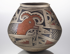 figure 5. Jar with featured serpant design